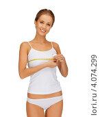 Купить «Юная девушка со стройной фигурой в белом белье с измерительной лентой в руках на белом фоне», фото № 4074299, снято 16 сентября 2012 г. (c) Syda Productions / Фотобанк Лори