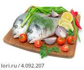 Купить «Рыба дорадо и овощи на белом фоне», фото № 4092207, снято 6 декабря 2012 г. (c) Ласточкин Евгений / Фотобанк Лори