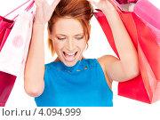 Купить «Счастливая молодая женщина с пакетами в руках после удачного шоппинга», фото № 4094999, снято 14 ноября 2009 г. (c) Syda Productions / Фотобанк Лори