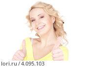 Купить «Счастливая девушка с поднятым вверх большим пальцем на руке», фото № 4095103, снято 31 октября 2009 г. (c) Syda Productions / Фотобанк Лори
