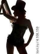 Купить «Силуэт девушки в корсете и щляпе со стремянкой», фото № 4108159, снято 30 сентября 2009 г. (c) Syda Productions / Фотобанк Лори