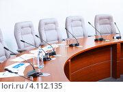 Купить «Круглый стол с микрофонами для конференции», фото № 4112135, снято 20 октября 2012 г. (c) Sergey Nivens / Фотобанк Лори