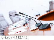 Купить «Микрофоны на столе в конференц-зале», фото № 4112143, снято 20 октября 2012 г. (c) Sergey Nivens / Фотобанк Лори