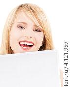 Купить «Счастливая молодая женщина с белым ноутбуком», фото № 4121959, снято 31 мая 2009 г. (c) Syda Productions / Фотобанк Лори