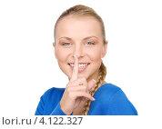 Купить «Очаровательная молодая женщина призывает хранить секрет, приложив указательный палец к губам», фото № 4122327, снято 8 мая 2010 г. (c) Syda Productions / Фотобанк Лори