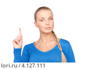 Купить «Молодая женщина предупреждающе подняла указательный палец», фото № 4127111, снято 8 мая 2010 г. (c) Syda Productions / Фотобанк Лори