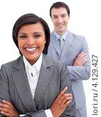 Купить «Улыбающаяся деловая женщина и его коллега на заднем плане», фото № 4129427, снято 4 октября 2009 г. (c) Wavebreak Media / Фотобанк Лори