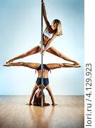 Купить «Две девушки танцуют с шестом», фото № 4129923, снято 4 марта 2012 г. (c) chaoss / Фотобанк Лори