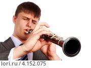 Купить «Молодой музыкант играет кларнете», фото № 4152075, снято 23 декабря 2012 г. (c) Сергей Лаврентьев / Фотобанк Лори