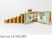Купить «Банкноты долларов и стопки золотых монет», фото № 4152907, снято 25 ноября 2012 г. (c) Mikhail Starodubov / Фотобанк Лори