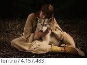 Купить «Славянская девушка обнимает хаски в ночном лесу», фото № 4157483, снято 17 ноября 2012 г. (c) Дмитрий Черевко / Фотобанк Лори