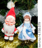 Купить «Дед Мороз и Снегурочка на елке», фото № 4158079, снято 1 января 2013 г. (c) Олег Пчелов / Фотобанк Лори