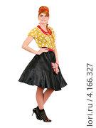 Купить «Стильная девушка в желтой блузке и черной юбке в стиле ретро», фото № 4166327, снято 23 декабря 2011 г. (c) Сергей Сухоруков / Фотобанк Лори