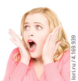 Купить «Привлекательная девушка удивляется на белом фоне», фото № 4169939, снято 28 марта 2010 г. (c) Syda Productions / Фотобанк Лори