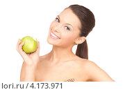 Купить «Красивая молодая женщина с зеленым яблоком в руке», фото № 4173971, снято 28 февраля 2010 г. (c) Syda Productions / Фотобанк Лори
