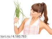 Купить «Счастливая девушка с челкой и зеленым луком в руках на белом фоне», фото № 4180783, снято 27 июня 2010 г. (c) Syda Productions / Фотобанк Лори