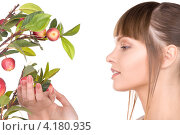 Купить «Юная девушка с яблоневой веткой с яблоками на белом фоне», фото № 4180935, снято 13 марта 2010 г. (c) Syda Productions / Фотобанк Лори