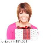 Купить «Счастливая женщина с подарком в руках на белом фоне», фото № 4181031, снято 26 декабря 2009 г. (c) Syda Productions / Фотобанк Лори