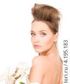 Купить «Привлекательная молодая женщина с длинными волосами с нежным цветком в руке», фото № 4195183, снято 14 марта 2010 г. (c) Syda Productions / Фотобанк Лори