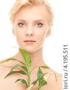 Купить «Привлекательная молодая женщина с зеленым комнатным растением на белом фоне», фото № 4195511, снято 24 июля 2010 г. (c) Syda Productions / Фотобанк Лори