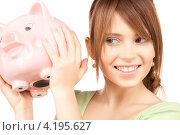 Купить «Молодая женщина с накоплениями в розовой копилке-свинье», фото № 4195627, снято 4 октября 2009 г. (c) Syda Productions / Фотобанк Лори