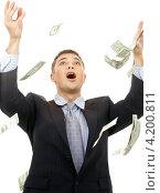 Купить «Менеджер в офисном костюме под денежным дождем», фото № 4200811, снято 20 октября 2007 г. (c) Syda Productions / Фотобанк Лори