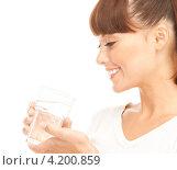 Купить «Счастливая девушка пьет из стакана на белом фоне», фото № 4200859, снято 27 июня 2010 г. (c) Syda Productions / Фотобанк Лори