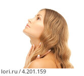 Купить «Портрет соблазнительной девушки со светлыми волосами и идеальной кожей на белом фоне», фото № 4201159, снято 14 августа 2010 г. (c) Syda Productions / Фотобанк Лори