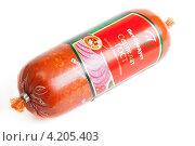 Купить «Колбаса сервелат, сделанная по ГОСТу», фото № 4205403, снято 30 сентября 2012 г. (c) Сергей Дубров / Фотобанк Лори