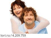 Купить «Счастливая семейная пара средних лет. Женщина обнимает мужчину на белом фоне», фото № 4209759, снято 17 декабря 2012 г. (c) Сергей Новиков / Фотобанк Лори