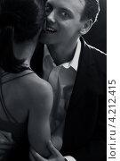 Купить «Молодой человек в костюме кусает девушку за ухо», фото № 4212415, снято 28 января 2006 г. (c) Syda Productions / Фотобанк Лори