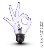 Электрическая лампа с колбой в виде руки с жестом ОК на белом фоне. Стоковое фото, фотограф Андрей Дыкун / Фотобанк Лори