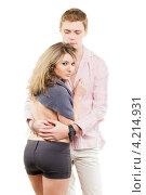 Купить «Влюбленная пара на белом фоне. Молодой человек обнимает девушку», фото № 4214931, снято 3 февраля 2012 г. (c) Сергей Сухоруков / Фотобанк Лори