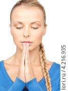 Купить «Молодая офисная сотрудница в голубом джемпере сложила перед собой руки в молитве», фото № 4216935, снято 8 мая 2010 г. (c) Syda Productions / Фотобанк Лори
