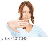 Купить «Расстроенная девушка просит остановиться, выставив руку вперед», фото № 4217243, снято 11 сентября 2010 г. (c) Syda Productions / Фотобанк Лори