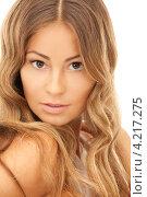 Купить «Очаровательная стройная молодая женщина с длинными русыми волосами на белом фоне», фото № 4217275, снято 14 августа 2010 г. (c) Syda Productions / Фотобанк Лори