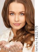 Купить «Привлекательная девушка со снегом в ладонях», фото № 4222775, снято 10 октября 2010 г. (c) Syda Productions / Фотобанк Лори