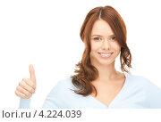 Купить «Веселая молодая женщина подняла большой палец на руке вверх на белом фоне», фото № 4224039, снято 11 сентября 2010 г. (c) Syda Productions / Фотобанк Лори