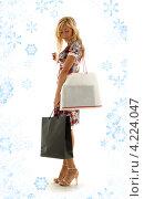 Купить «Счастливая покупательница с пакетами в руках после прогулки по магазинам», фото № 4224047, снято 15 августа 2006 г. (c) Syda Productions / Фотобанк Лори