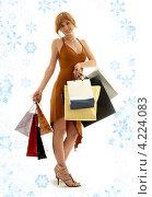 Купить «Счастливая покупательница с пакетами в руках после прогулки по магазинам», фото № 4224083, снято 19 августа 2006 г. (c) Syda Productions / Фотобанк Лори