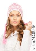 Купить «Симпатичная девушка в зимней шапке на белом фоне», фото № 4225499, снято 10 октября 2010 г. (c) Syda Productions / Фотобанк Лори
