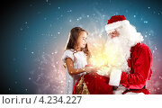 Купить «Красивая нарядная девочка и дед Мороз с мешком подарков», фото № 4234227, снято 28 сентября 2012 г. (c) Sergey Nivens / Фотобанк Лори