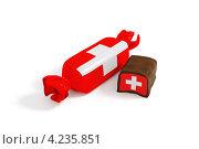 Шоколадная конфета на белом фоне. Фантик и начинка с текстурой флага Швейцарии. Стоковая иллюстрация, иллюстратор Андрей Дыкун / Фотобанк Лори