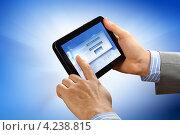 Купить «Современный планшетный компьютер с окном ввода логина и пароля в руках на синем фоне», фото № 4238815, снято 5 ноября 2012 г. (c) Sergey Nivens / Фотобанк Лори