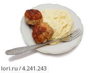 Порция картофельного пюре с мясными котлетами на тарелке. Стоковое фото, фотограф Наталья Осипова / Фотобанк Лори
