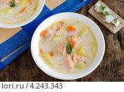 Купить «Сырный суп с семгой и овощами в белой миске на деревянном столе», фото № 4243343, снято 29 апреля 2010 г. (c) Татьяна Пинчук / Фотобанк Лори