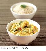 Купить «Азиатская кухня, тыква с карри и рис», фото № 4247255, снято 24 января 2019 г. (c) Food And Drink Photos / Фотобанк Лори