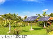 Купить «Панели солнечных батарей в саду», фото № 4252827, снято 19 января 2013 г. (c) Dmitry Burlakov / Фотобанк Лори