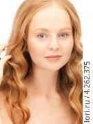 Купить «Юная девушка с вьющимися рыжими волосами на белом фоне», фото № 4262375, снято 27 ноября 2010 г. (c) Syda Productions / Фотобанк Лори