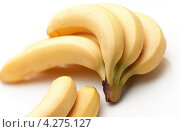 Купить «Несколько бананов на белом фоне», фото № 4275127, снято 16 сентября 2019 г. (c) Food And Drink Photos / Фотобанк Лори